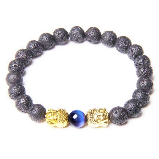 Bracelet pierre de lave avec deux têtes de bouddha dorées et une perle bleu