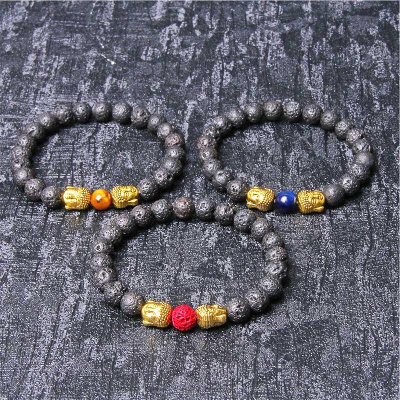 3 bracelets en perles de pierre de lave et tête de bouddha dorée