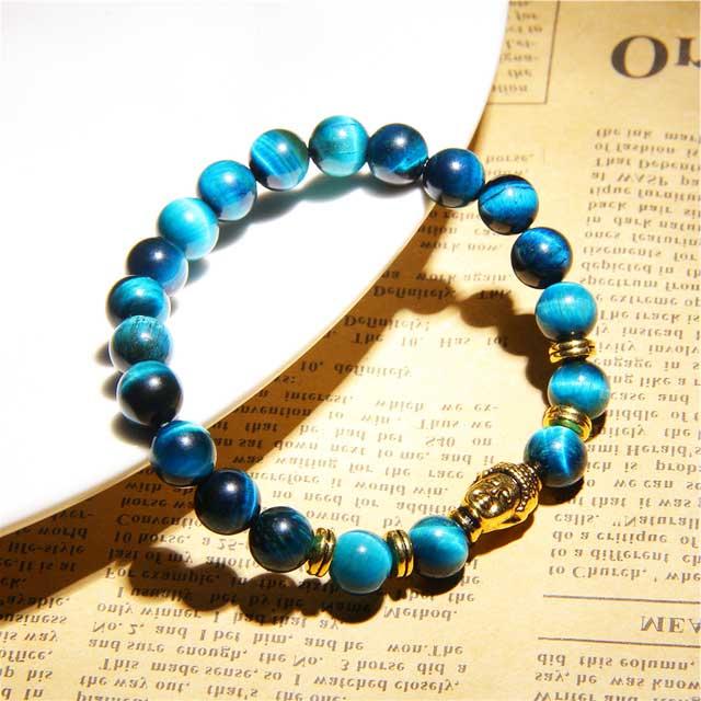 Bracelet bleu oeil de faucon et tête de bouddha zen doré