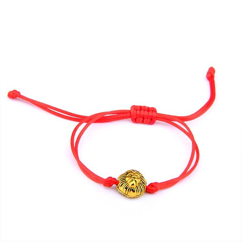 Bracelet tibétain fil rouge et tête de lion doré